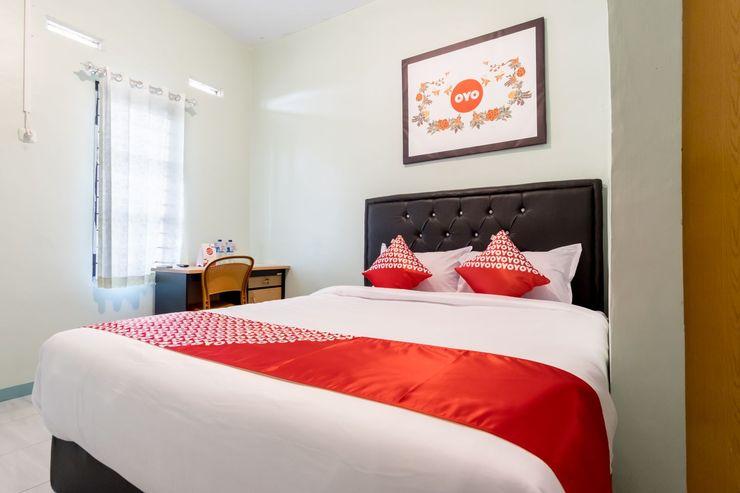 OYO 1184 Aladinmar Medan - Bedroom