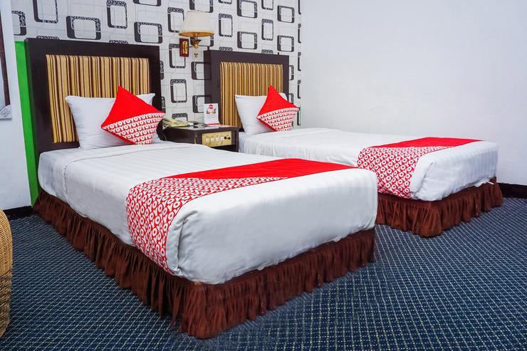 OYO 403 Flaminggo Halal Padang Panjang - SUIT TWIN BEDROOM