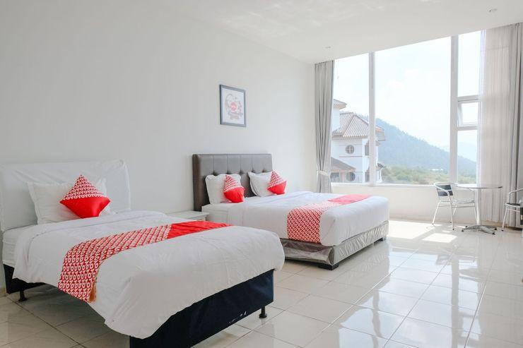 OYO 1194 Villa Bukit Panderman Residence Malang - Bedroom