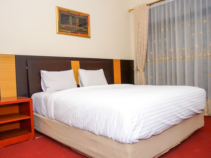 Edotel Palembang - Bedroom