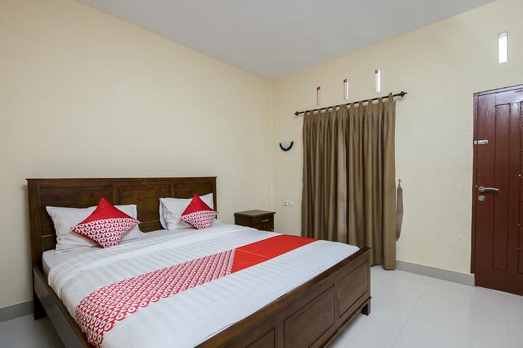 OYO 1488 Prima Hotel Danau Toba - Bedroom DD