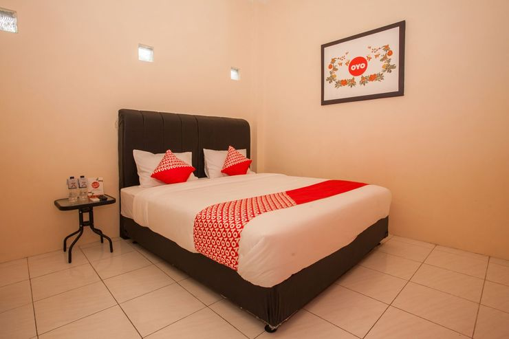 OYO 1031 ZK Home Stay Medan - Bedroom