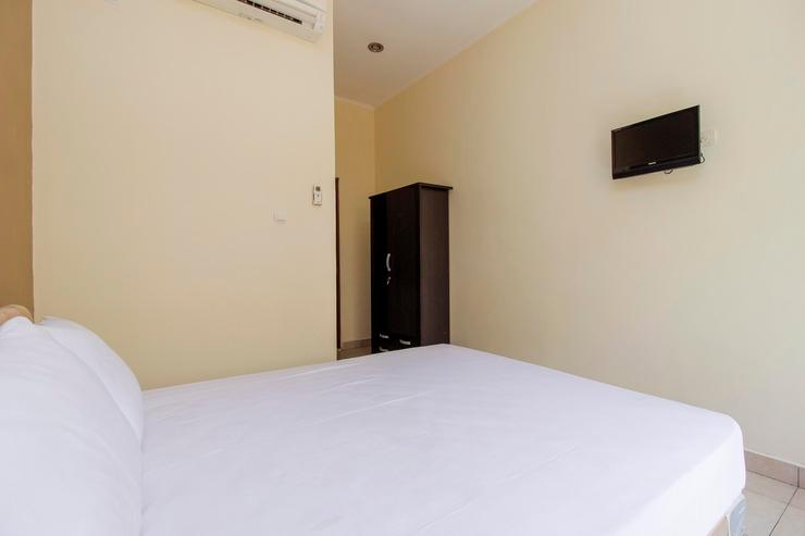 My Place Guesthouse Manado - Bedroom