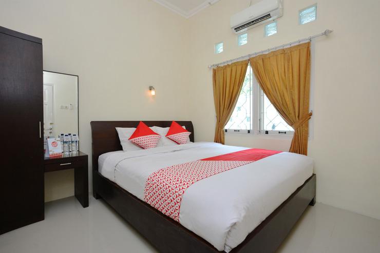 OYO 722 Uno Guesthouse Yogyakarta - Bedroom
