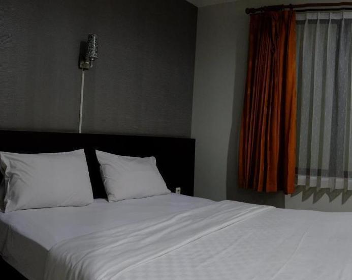 LeGreen Suite Ambon - Kamar