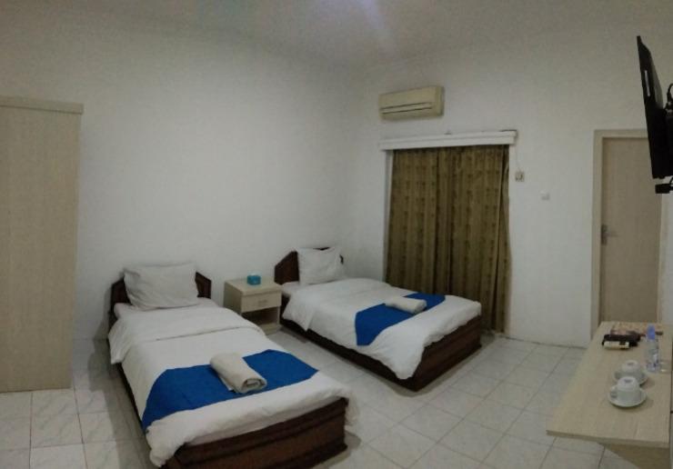 Hotel Sanashtri by SHM Solo - kamar tidur