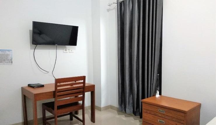 Al Cholil Homestay Balikpapan - Bedroom