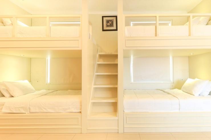 HOME Guesthouse Surabaya - Rooms