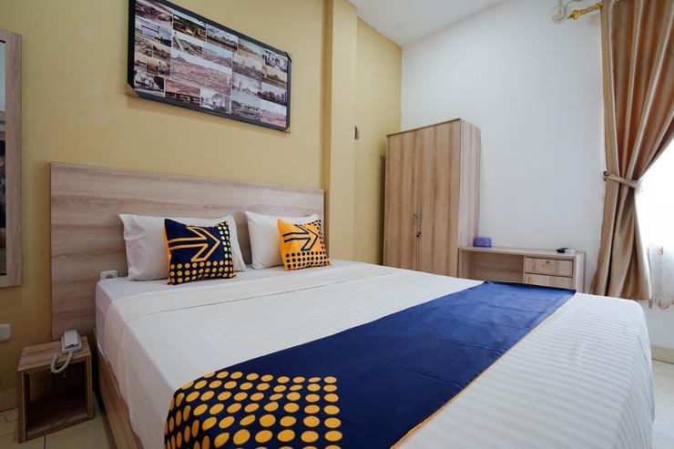 SPOT ON 2869 Ionia Homestay Palembang - Bedroom