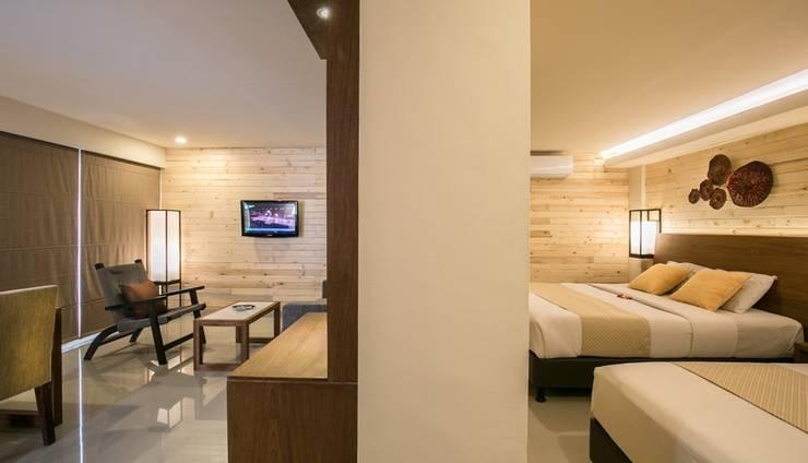Casa Padma Suites Legian - Kamar Deluxe suites