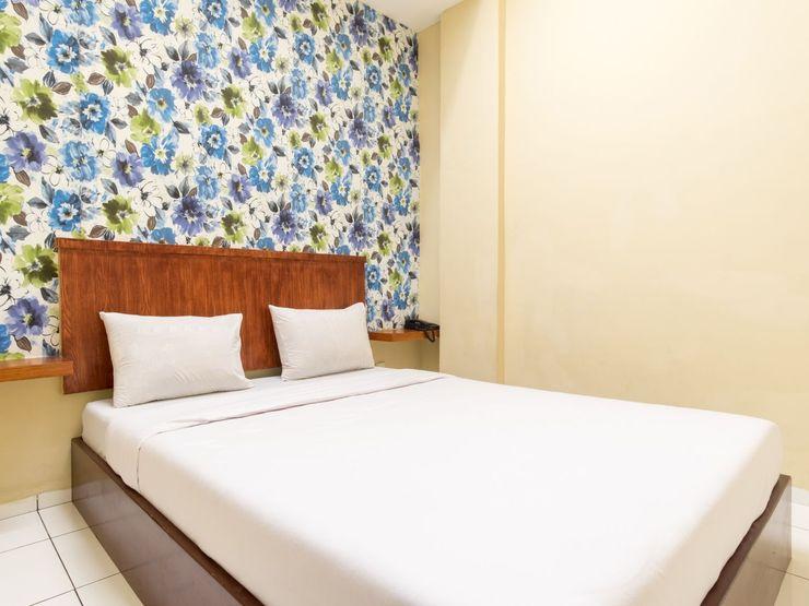Residence Puri Hotel Medan - Bedroom