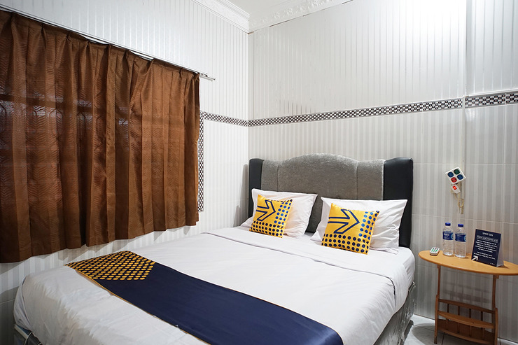 SPOT ON 1854 Sepinggan Asri Syariah Guesthouse Balikpapan - Standard Double Bedroom