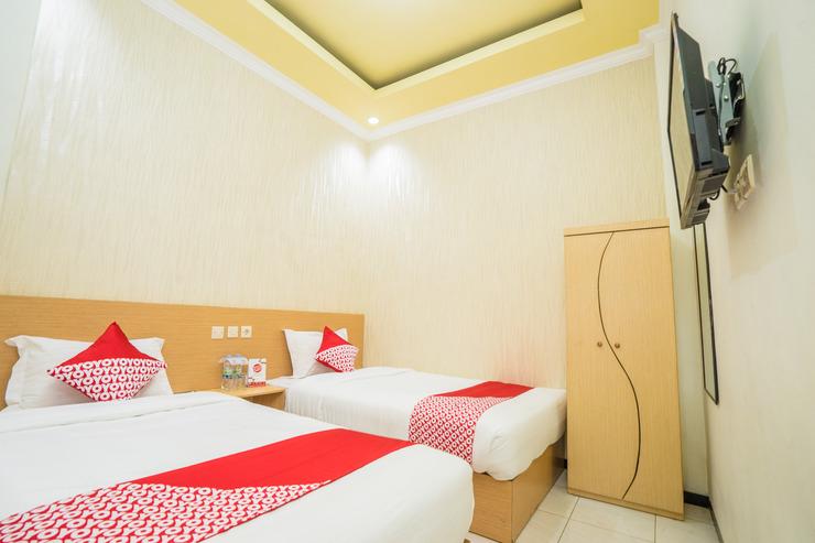 OYO 565 Mutiara Panderman Inn Syariah Malang - Bedroom