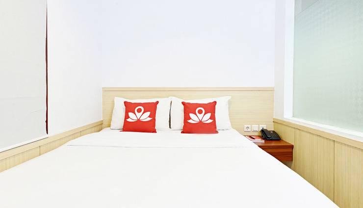 ZenRooms Ciumbuleuit - Tampak Tempat Tidur Double