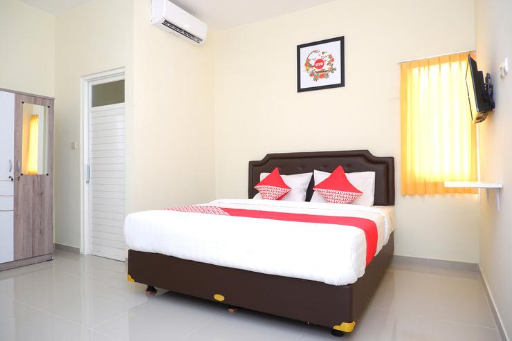 OYO 1041 Ayuning Guesthouse Semarang - Bedroom