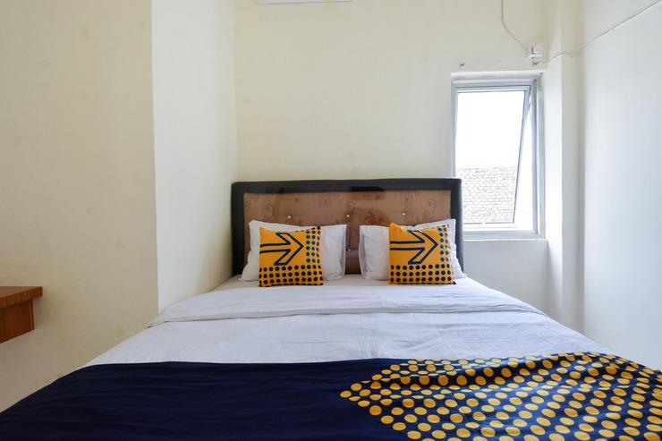 SPOT ON 2422 Kost Laguna Palembang - Bedroom