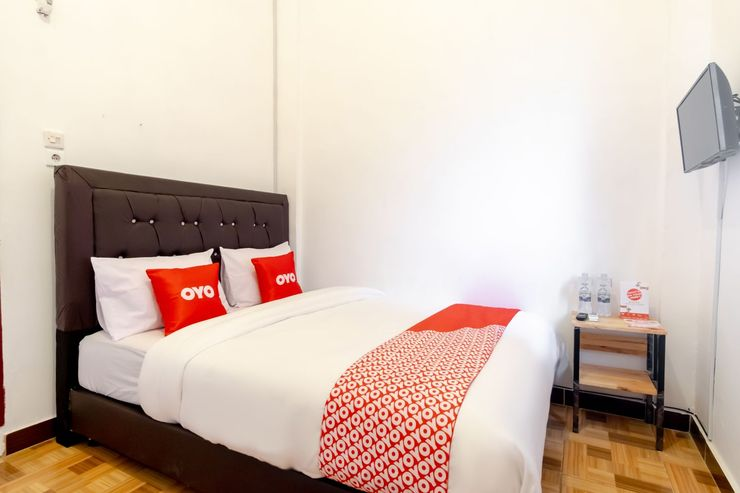 OYO 1874 Joh - Je Guest House Medan - Bedroom