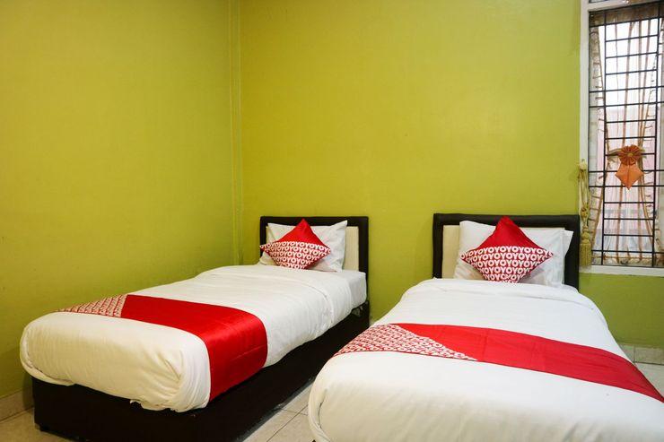 OYO 1156 Fanybella Homestay Pekanbaru - Bedroom