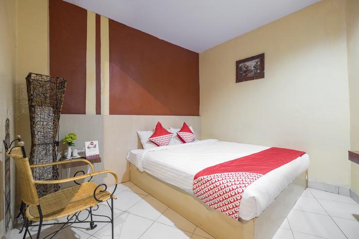 OYO 500 Nilam Residence Makassar - Bedroom