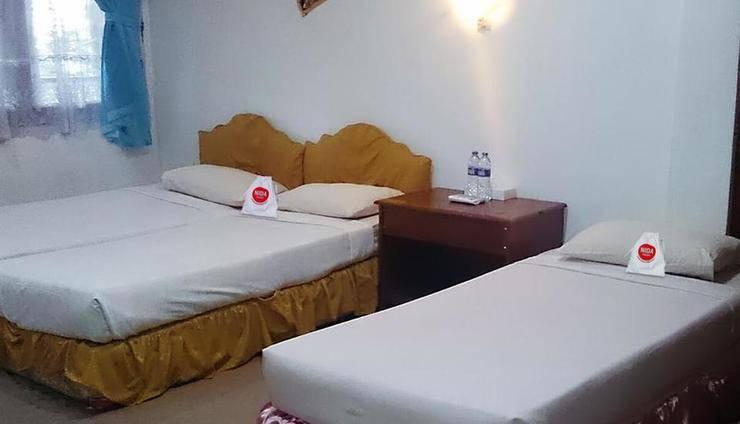 NIDA Rooms Lombok Batu Bolong - Kamar tidur