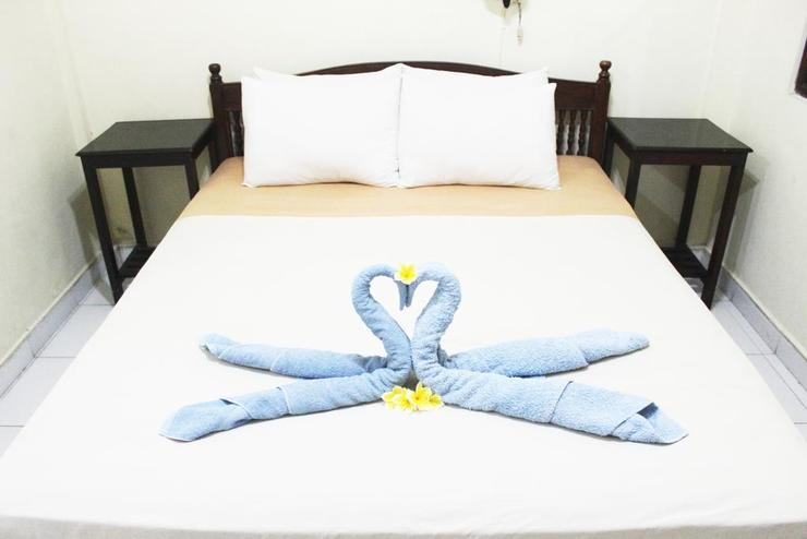 Segara Sadhu Inn Bali - kamar tidur