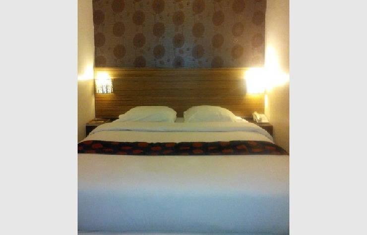 NIDA Rooms Sri Wijiya 136 Mataram - Kamar tidur