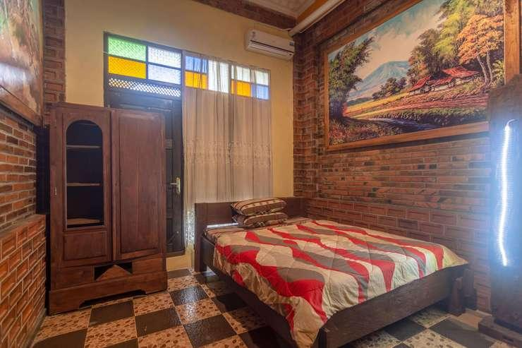 Joglo Kalkun Guest House Yogyakarta - bedroom