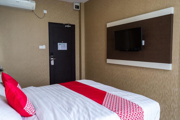 OYO 676 Nasa Hotel Batam - suit double bedroom