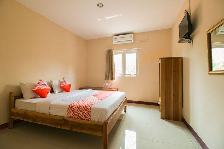OYO 946 Penginapan Menara Megah Syariah Sukabumi - Bedroom