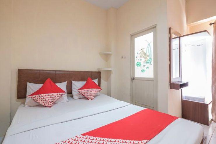 OYO 1691 Wisma Benhil Toddopuli Makassar - Bedroom