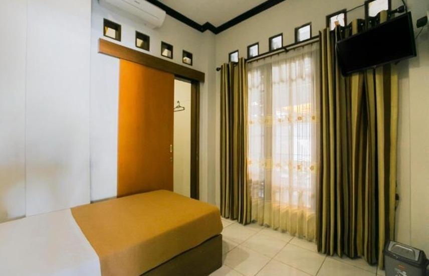 Santo Guest House Surabaya - Kamar Superior