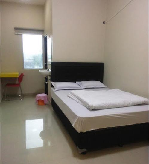 Hotel Srikandi Bandara Jogja - Room King Regular Plan
