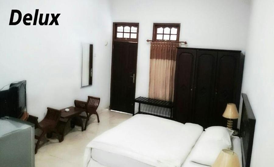 Avicenna Hotel Palangkaraya -  Kamar deluxe dengan 1 kasur besar