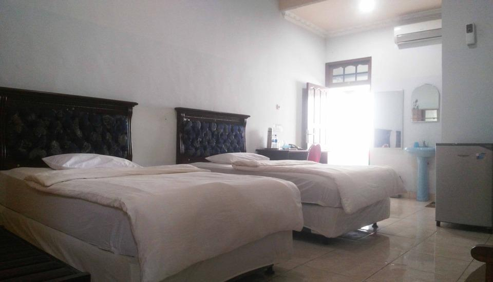 Avicenna Hotel Palangkaraya - Kamar deluxe dengan 2 kasur kecil