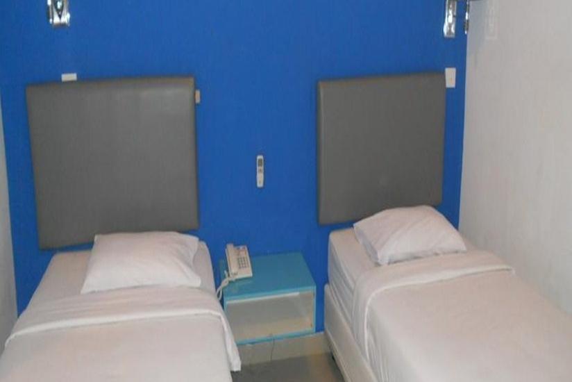 Parma Panam Hotel Pekanbaru - Kamar Tamu