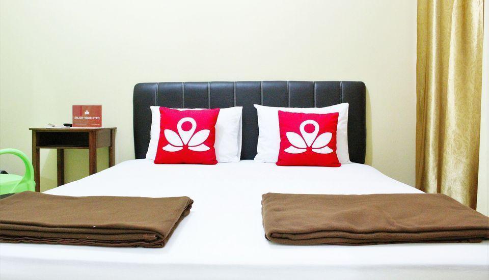 ZenRooms Wahid Hasyim Syariah Jakarta - Tampak tempat tidur double
