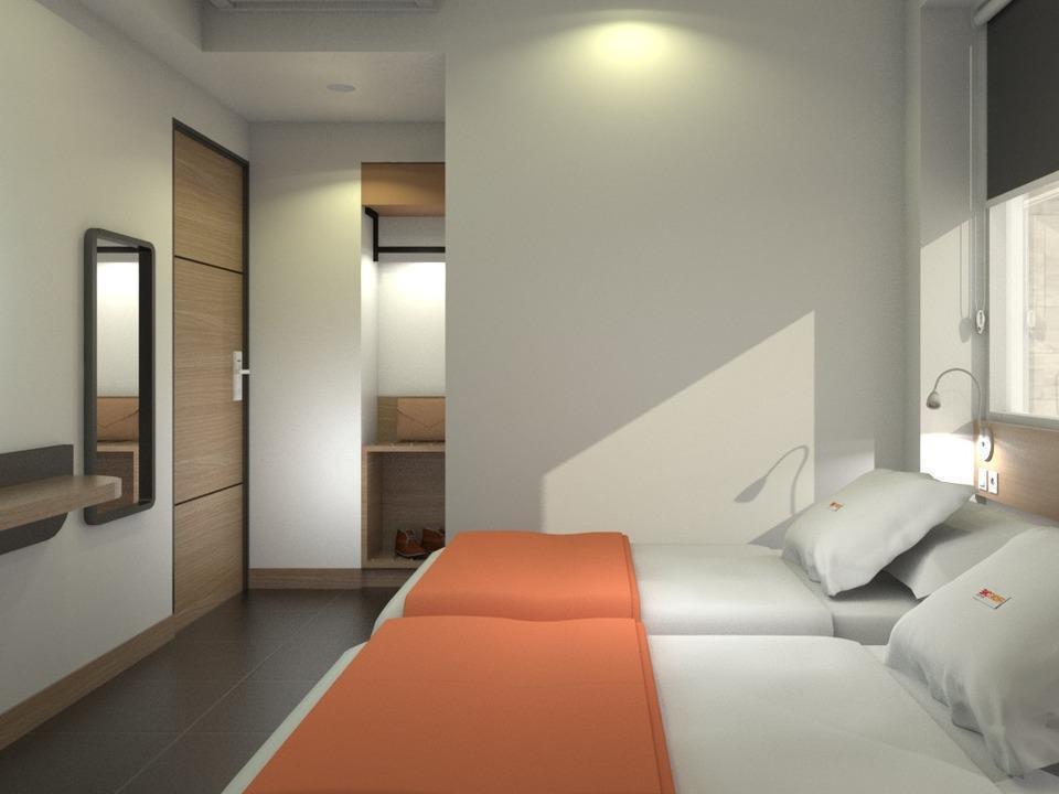Front One Inn Kediri Kediri - Guest room