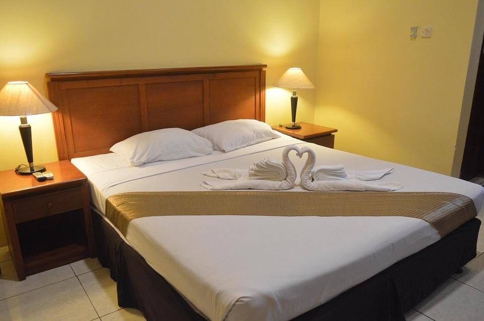 Kamar penginapan di BJ Perdana Hotel