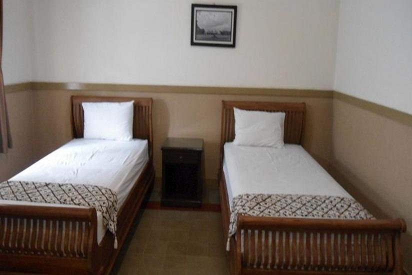 Ndalem Suratin Guest House Yogyakarta - Lotus Room Regular Plan
