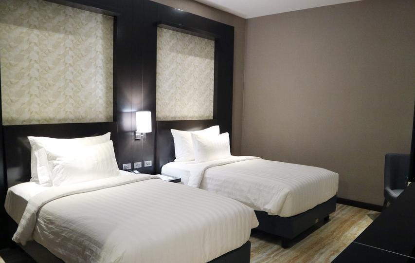 Grand Karlita Hotel Purwokerto Purwokerto - Standard Twin Smoking Room Regular Plan