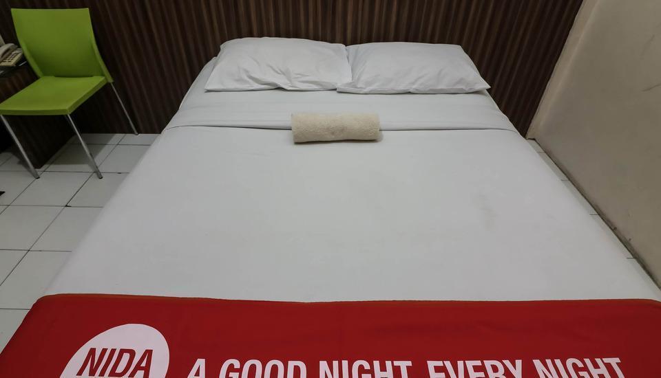 NIDA Rooms Sudirman 240 Marpoyan Damai Pekanbaru - Kamar tamu