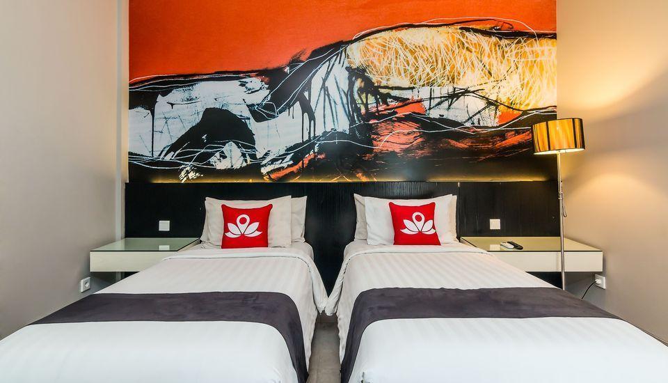 ZenRooms Melasti Legian Kuta - Tampak tempat tidur twin