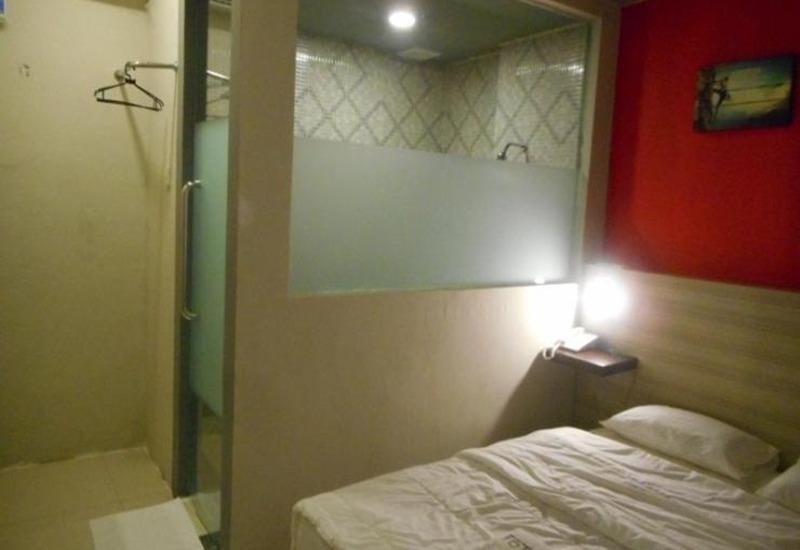 Total X Inn Palu - Kamar tamu