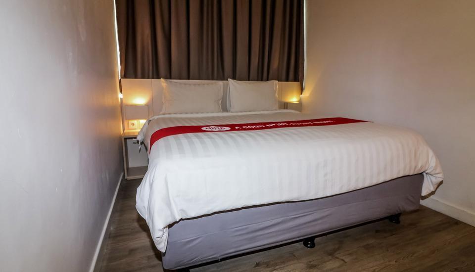 NIDA Rooms Pantai Indah North 3 Jakarta - Kamar tamu