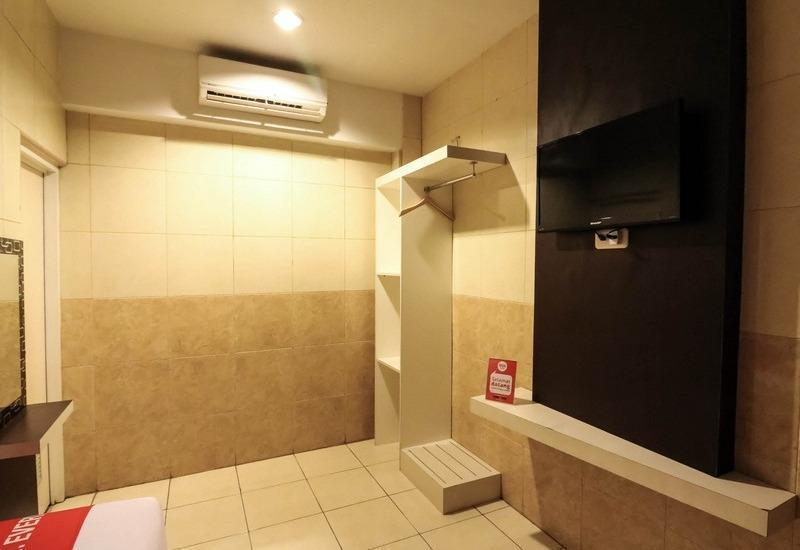 NIDA Rooms Makassar Nusantara Losari - Kamar tamu