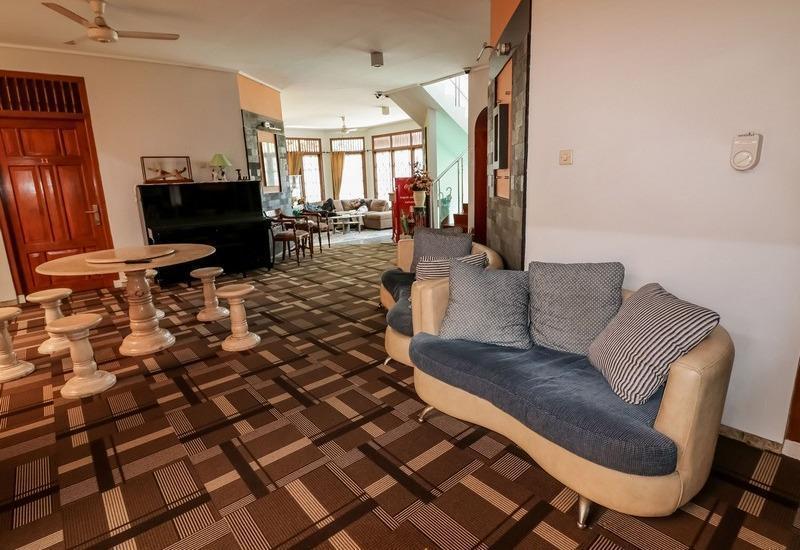 NIDA Rooms Mircan Baru Depok Airport Jogja - Ruang tamu