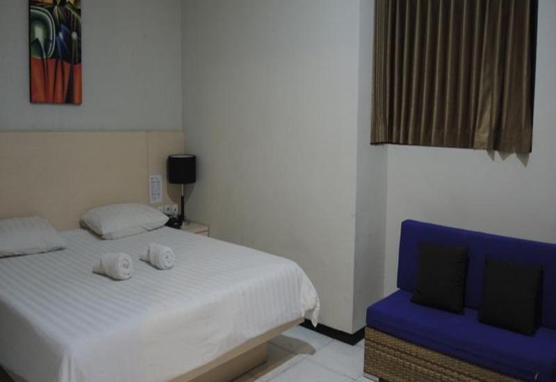 Hotel SWK 95 Surabaya - Kamar Deluxe