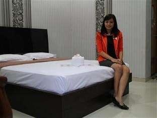 Eljie Hotel Gorontalo - Kamar tidur