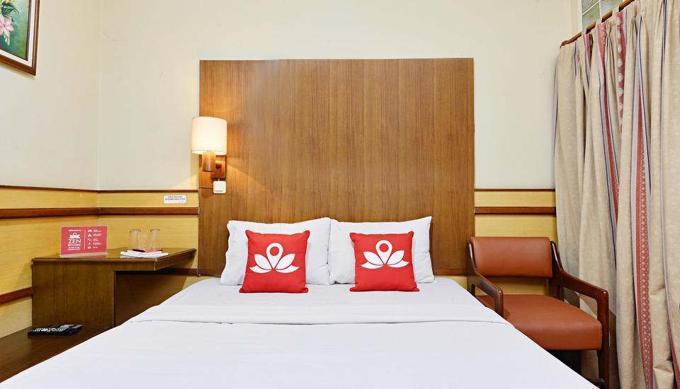 ZenRooms Lodaya - Tampak tempat tidur double
