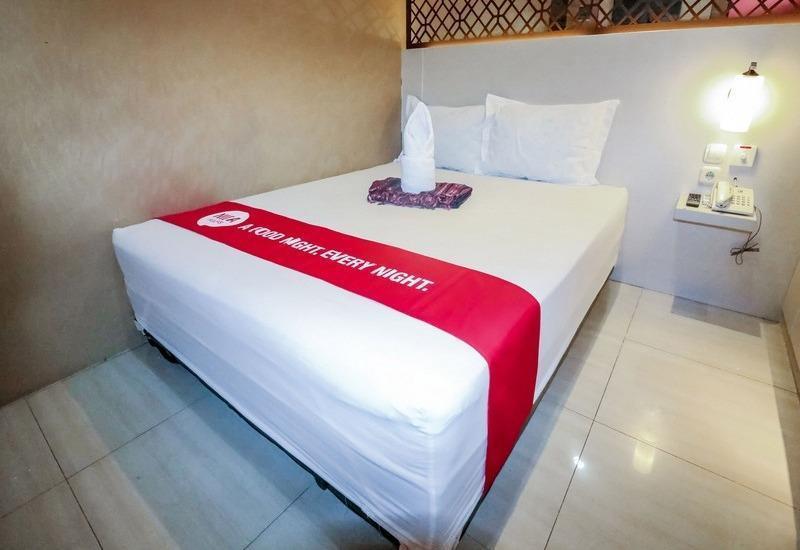 NIDA Rooms Raya Dukuh Kupang 50 Surabaya - Kamar tamu